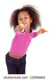 Little African Asian girl sharing a tangerine ,isolated on white background