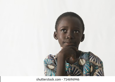 Little African boy thinking about his future, isolated on white