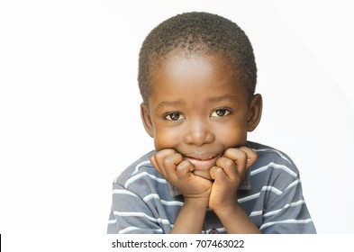 Little African child holding his head in his hands thinking about his future