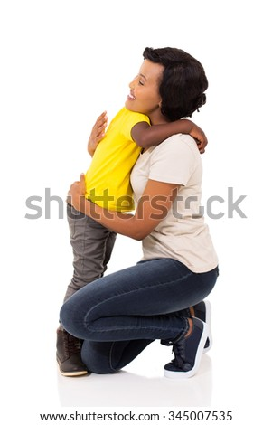 little afro american boy hugging his pretty mother on white background