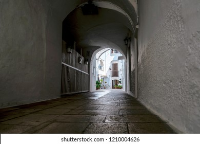 Little alley in the medieval center of the white village of Locorotondo