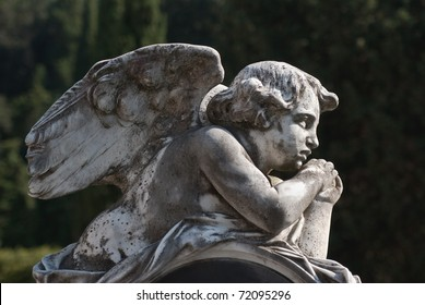 little angel lying outdoors