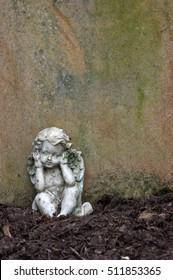 little angel sculpture decorate in small garden