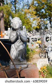 Little angel sculpture on a tombstone