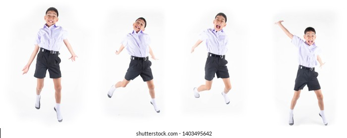 Little Asain boy in student uniform jumping on white background