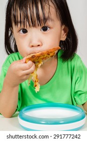 Little Asain Chinese Eating Pizza in white background