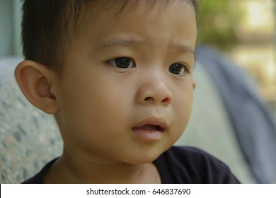 little asia boy in black shirt