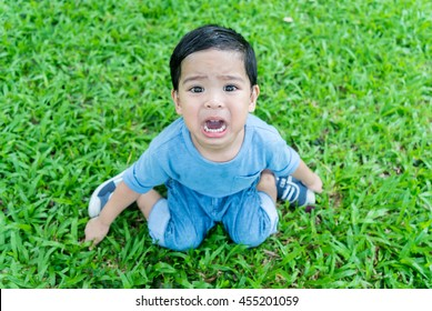 Little asian boy crying bitterly