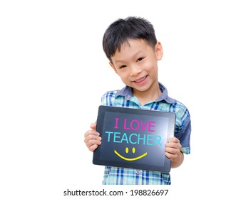 "Little asian boy holding tablet computer with word ""I love teacher"" on screen"