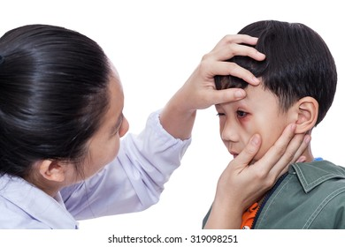 Little asian boy with an injured eye. Doctor examining and first aid a patient injured on left eye bruise. Studio shot. On white background