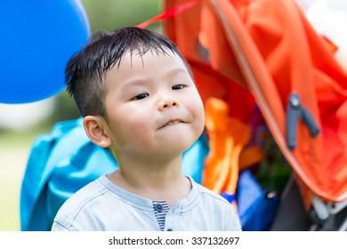Little asian boy make a funny face