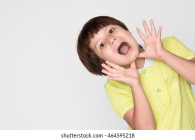 little asian boy on gray background