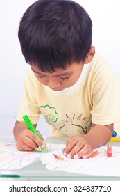 a little asian boy paint color on white paper on white background