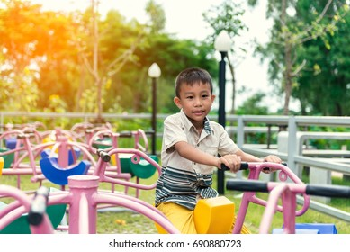 Little Asian boy are playing happily at the playground.