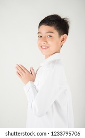 Little asian boy praying in Thai costume  isolate on white background
