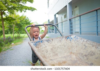 Father Pushing Son Wheelbarrow Images Stock Photos