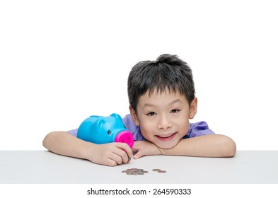 Little Asian boy sitting with piggy bank over white background