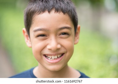 Little Asian boy smile on his happy face in the park