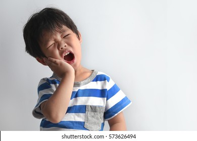 Little Asian boy suffering from toothache - Dental problem.