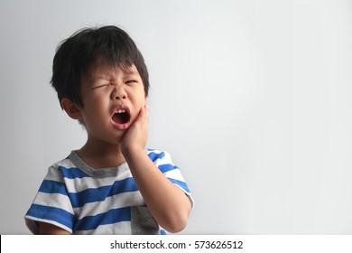 Little Asian boy suffering from toothache - Dental problem.