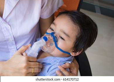 Little Asian boy under anesthesia with an oxygen mask in hospital