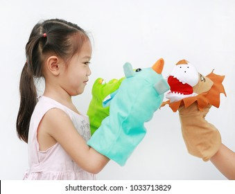 Little Asian child girl hands playing animal puppets on white background. Educations concept.