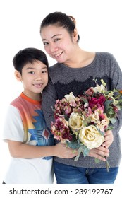 Little asian child holding bouquet in hand and mother on with background .