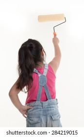 Little Asian child painting the wall on isolated back ground