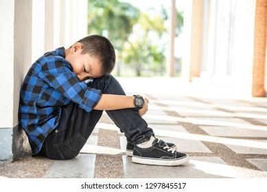 Little asian child sleeping. Depressed asian boy. Young asian boy sad