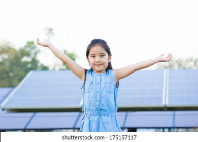 Little Asian child with solar cell panels