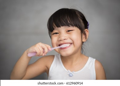 Little asian cute girl brush teeth