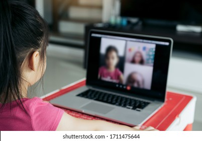 Little asian girl attending to online e-learning platform class from home while school has been closed during coronavirus outbreak.