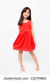 Little Asian girl in beautiful red dress