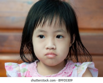 little asian girl bored