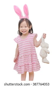Little Asian girl with bunny ears over white