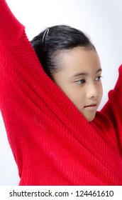 little asian girl changing costume on studio