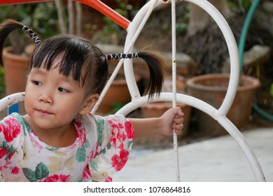 The little Asian girl with the cute hair style.