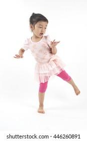 little asian girl dancing like bird in pink dress