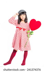 Little Asian girl with the decor heart posing on white background