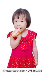 Little Asian girl eating donut over white