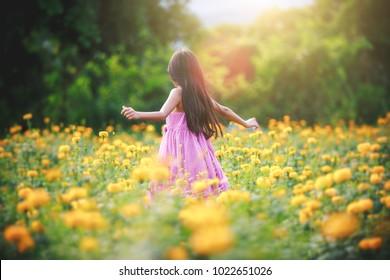 Little asian girl in flower fields, Outdoor portrait