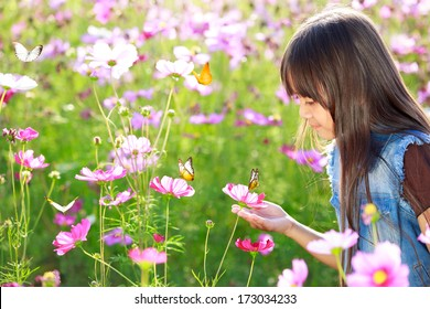 Little asian girl in flower fields, Outdoor
