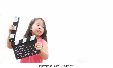 Little asian girl hands holding clapper board for making video cinema in studio.Kids Movie production with clapper board or slate film concept.isolated on white background.