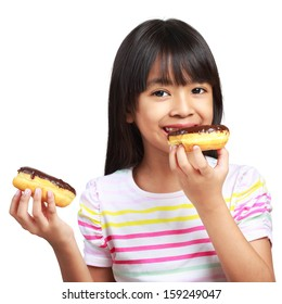 Little asian girl holding and eating chocolate donuts, Isolated on white background