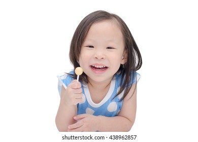 little asian girl holding a lollipop over white