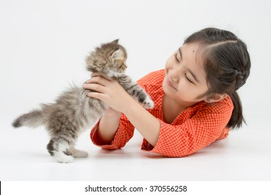 Little Asian girl hugging lovely Persian kitten on isolated