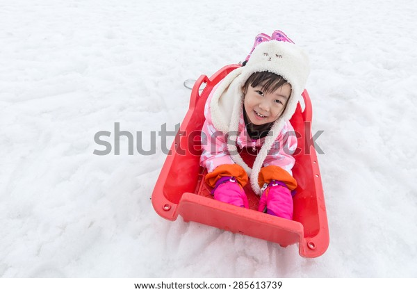 little asian girl play snow