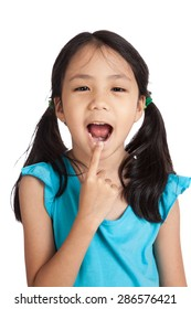 Little asian girl point to her mouth  isolated on white background