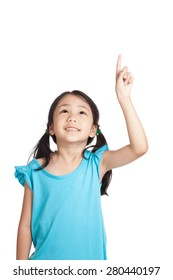 Little asian girl point up and look up  isolated on white background