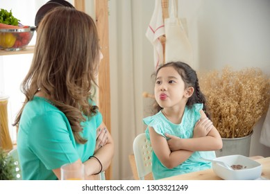 Little asian girl refuse to having breakfast with her mother,picky eater concept.